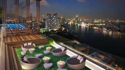 or lying on the sofa on a Green rooftop of the Hotel